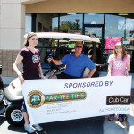 George was awarded his prize by Jennifer (left) and Amanda (right) from Par-Tee Time Golf Carts of Sun Lakes who provided the cart for this year's raffle.