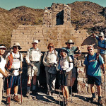 Hikers posing in front of ruins in South Mountain Park.