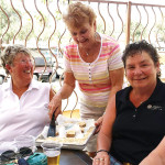 Barb Hansen serving Lynda Smith and Marci Koppelmaa.