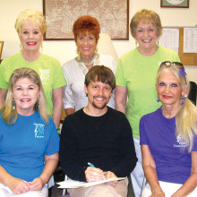 Pictured from left are Sheri Hopkins, Barbie Bergerson, Chris Roen, Patti Entwistle, Adam Thome and Patrice Reis, the Search Committee and the Sought After One at joyful recent contract signing.