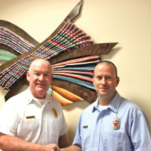 Sun Lakes Fire Department Chief Paul Wilson congratulates Capt. Craig Dimerling on his 15th anniversary with the SLFD.