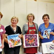 Ellie Cumberland, Judy Yaryan, Diane Hitt, Joyce Weary and Rose Sumners with their batiks.