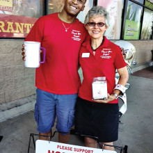 Julian Wyatt and Gabe Fosberg in front of Fry's Laveen store.