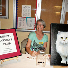 Shirley Shoemaker and her White Cat encourage local artists to join the Desert Artist's Club!