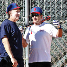 """""""That ball was this far outside!"""" Chuck Schaan (right) discusses the finer points of umpiring with Kenny Brenden. (Photo by Core Photography, LLC)."""