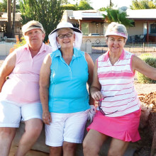The three Cottonwood women who were taking advantage of one of the many trees that were downed on the golf course are Mary Nelson, Billie Seiberling and Janet Quade.