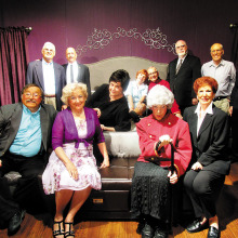 (Seated in front) Ted Peck, Carole Hollar, Janine Schneck, Gloria Kelinson (On bed) Merrie Crawford, Joyce Recupido, Bud Jenssen (Standing) Bob Rouleau, Bill Munn, John Crawford, Jim Thorbourn And last but not least – all in black – Mike Carter