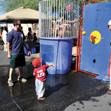Take your best shot at the dunk tank at the second annual Welcome Back Party/Community Fair sponsored by Neighbors Who Care on October 25!