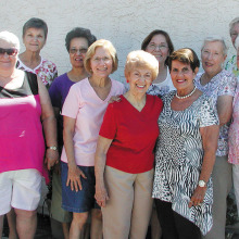 Some members of the Sun Lakes Garden Club are outside of the Chapel Center.