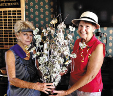Barbara DeNapoli presenting El Hinerichsen a money tree in celebration of her August wedding.