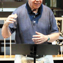 Bill Bade directs Risen Savior Church Choir during rehearsal.