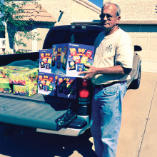 Pictured is Tom Whittenberg, Junior Vice-Commander, Sun Lakes VFW Post 8053, helping unload a truck full of drinks, snacks and goody bags which VFW Auxiliary Post 8053 provided to the many youth participating in Operation Kids held at Luke Air Force Base on October 25.