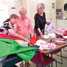 Pictured left to right are Johnnie Schofield, Rose Zimmer and Vickie Buholz going through some of the items we received this month. Photo by Viv Sloane.