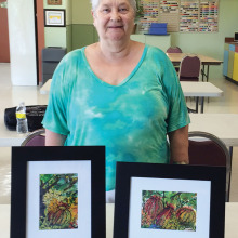 Mika Baltyn with samples of her beautiful work.