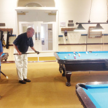 IronOaks Breakers Pool League member Bill O'Donnell preparing for his next shot. Photo taken by Willie Foster.