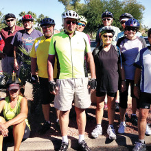 Riders gather at the flagpole in Cottonwood before a Monday ride.