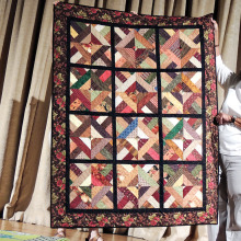 President Faith Bragg participates in the show and tell at the Agave Quilters meeting.