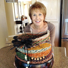 Guest artist is member Kathy Olds showing her woven basket with a gourd base. It includes seagrass, wool, reeds and beads. The other basket uses several mediums include woodburning and alcohol stain with a woven seagrass top. The inlay is a piece of art from the De Grazia museum.