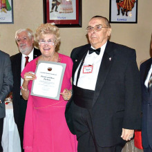 Sun Lakes residents Rose and Dennis Pachura (center) receive an award for their continued support and services to the Pulaski Club.