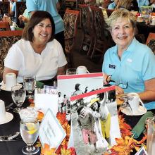 Longtime OLNGA volunteer Marcie Noble (right) and new member Denise Fleshner at the welcome back luncheon
