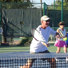 Rick Kenny displays his volley form during the club's clinic/mixer.