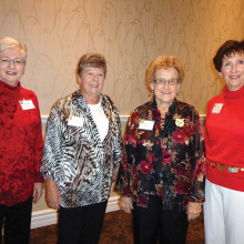 Sarah Welp, Angela Bailey, Helene Rusk and Kay Stanicek of P.E.O. Group B and C are ready to welcome others to the annual P.E.O. Coffee!