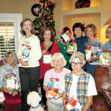 Members of the Women's Exchange Group made holiday bags for homeless women.