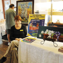 Bev Walter solicits artists for a previous Art at the Lakes.