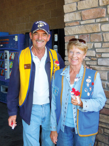 Neal Peer, Commander of Sun Lakes VFW Post 8053 and Betty Peer, President of the Post's Auxiliary, manning one of the doors at Arizona Avenue's Wal-Mart Store on Poppy Day, November 15.