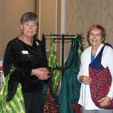 Agave Community Service Chairs Pat Johnson and Terri Austin proudly display carry bags headed for several area women's shelters.