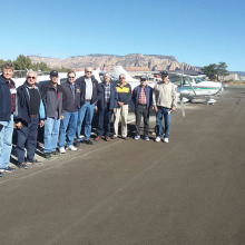 Sun Lakes Aero Club members enjoyed a fly-in breakfast to Sedona November 20: Pictured left to right are Steve Perkins, Ray Winenger, John Philp, Dick Simmons, Gary West, Bob DeLong, Tom Gorlinski, Gene Evans and Cannon Hill. (Photo by J. R. Scheidereiter).