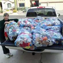 Johnnie Schofield standing next to her truck filled with 2,400 Beanie Babies which an anonymous person gave to us.