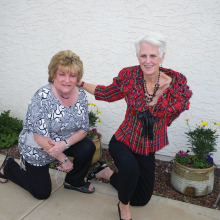 Paula Lauer (left) and Debby McDonald (right) in front of potted plants taken care of by the Sun Lakes Garden Club, which also takes care of the entire landscape for the Chapel Center.