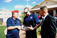 East Valley Marine Pat Rice presents Sgt. Robert Bruce with a certificate for donation from the detachment while Marine Master Sergeant Salvador Marquez of the Wounded Warrior Regiment looks on.