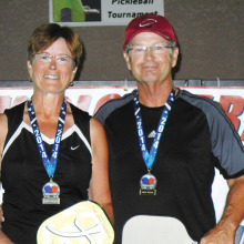Atop the podium are gold medal winners Jeannine and Kelly McKinna