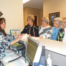 Pictured (left to right) Vincenza Heisler reviews New Adventures in Learning's class registration procedures with Sue Schwartz, Debbie Oliver, Marge Troche and Nadine Cords.