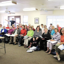 Members of the choirs of the Christian churches and Jewish congregation meet for the first rehearsal of their interdenominational choir for the Sun Lakes Choir Festival.