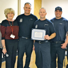 Co-leaders of the HLAOA group Regina Milgroom (left) and Liz Booth present SLFD members firefighter Roggeman, Captain Dimerling and firefighters Moreni and Johnson with a certificate thanking them for their presentation. (Photos and caption by Brian Curry).