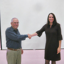 Judy Zimet, executive director of Dog is My Co-Pilot, was the featured speaker at the Sun Lakes Aero Club (SLAC) gathering December 15. Here she is shown with SLAC president Bob Walch.