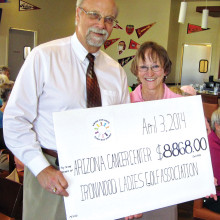 In this 2014 photo, Mark Weiss, Senior Director of Development For Arizona Health Development, accepts our donation from Betty Dupuis.