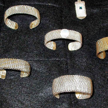A few of the jewelry pieces long time member Tom Hall has made; he has also made woven sterling jump-ring bracelets.