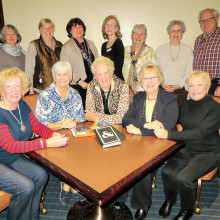 Cheers Singles Club meets the first Tuesday of the month for book club; 12 members are pictured.