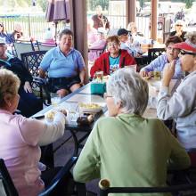 18 Holers league enjoys social time after golf!