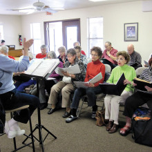 Interdenominational choir from the Sun Lakes Chapel rehearsing with director Lana Oyer of the Sun Lakes Jewish Congregation in preparation for Rockin' Our Souls concert.