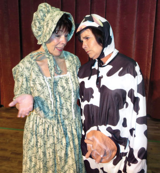 Frankie (Janine Schneck) reassures GJ (MaryEllen Buchwold) that the petting zoo will be a huge success.