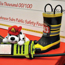 One of the three dual band emergency radios purchased by the Sun Lakes Fire Department with the Firehouse Sub foundation grant is posed at the Phoenix press conference.