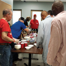 Lew Bradley, Dave Lott, Christine Rice and Bill McCaffrey assemble root beer floats for veterans.