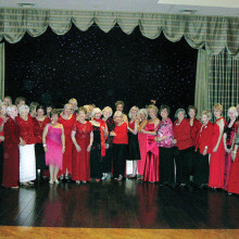 Radiant in red is a perfect description for the ladies who attended the club's February event. Watch for next month's photo of the debonair gentlemen.