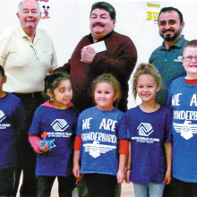 Sun Lakes Charities President Stan Scott, Ramon Elias and Chilo Figueroa with Boys and Girls Club kids