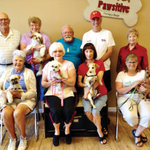 Pictured - row one are Bonnie Forbes with Tulley, Phyllis Johnson with Zoe, Mary Smitham with Rudy and Cindi Decker with Jimmy; row two are Tony Forbes, Paula Ferguson with Chloe, Charles Johnson, Steve Smitham and Pat Harpster; not pictured is Dale Harpster with Siri
